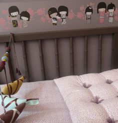 Kokeshi. I love these decals! and the crib.