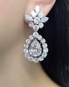 Dazzling diamond ear pendants by Van Cleef and Arpels each set with a pear-shaped diamond weighing 8cts. See this Instagram photo by @connieluk_christies •