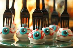 Eyeball cake pops with a fork stuck in them! Cute for a classroom Halloween party.