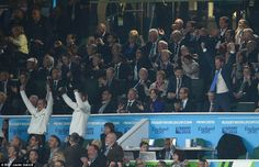 Celebrations: As England clinched their 35-11 victory against Fiji, the Duke and Duchess of Cambridge (front row, third and fourth from right) were seen clapping joyfully - as Harry (far right) got to his feet and punched the air. England's coaches (in white) also stood up