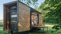 "The luxurious Alpha Tiny Home, which was recently showcased on HGTV's ""Tiny House, Big Living,"" boasts trend-forward details like reclaimed barn wood, subway tiles, hardwood floors, and a stainless steel farmhouse sink."
