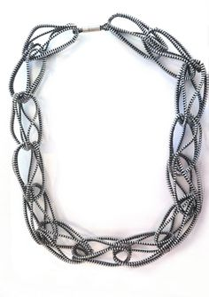 Introducing our newest artist at Gallery Lulo, Kate Cusack! Tri-loop necklace, made from black and silver zippers. Kate Cusack for Gallery Lulo.