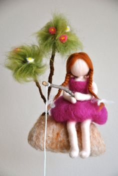 This is a Waldorf inspired piece made of wool by the needle-felting technique. Its been created to provide a peaceful and harmonious image that communicates with the soul through its colors, textures, forms and energy. Dimensions: Girl with tree : 9x8 in Doll: 8 in From top of tree to