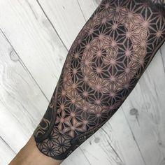 Sayagata patterned forearm tattoo.