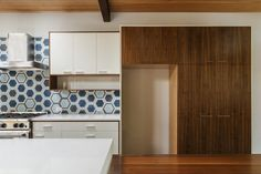 Add a bright backsplash. | 11 DIY Kitchen Projects You Won't Need A Contractor For