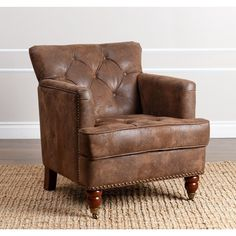 Add style to your home with the antique brown Tafton chair. This high-quality furniture from Abbyson Living is completed with a button-tufted back and rolling birch wood legs .