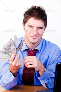 Businessperson holding money ...  advice, answer, assistant, beautiful, blue, business, businessman, businesspeople, businessperson, call, career, centre, communications, computer, counting, desk, dollar, focussing, friendly, girl, handsome, happy, help, helpful, holding, male, man, marketing, money, office, smile, success, support, talking, technology, telemarketing, telephone, tie, type, work, workers, young, youth