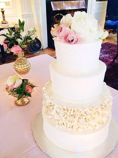 White cake with pink and floral accents