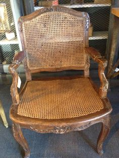 #Deskchair #Regence #caned in natural #beechwood. Carved with shells, mantling, acanthus leaves and volutes. Arm-rests in leather. 18th century. For sale on Proantic by Galerie de la Madeleine.