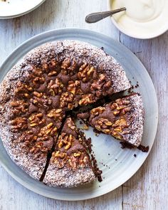 Eric Lanlard's take on classic Swiss chocolate cake, topped with toasted walnuts and a dusting of cocoa powder, is the perfect addition to afternoon tea.