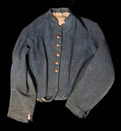 Confederate shell jacket worn by Pvt. Joe Paxton Lyle, Co. D, 63rd Tennessee Infantry Regimentt., CSA.  The buttons indicate artillery, though Lyle did not serve in artillery. The jacket is Richmond Depot issue. Lyle fought at the Battle of the Crater, was captured at Petersburg, and imprisoned at Ft. Delaware Prison.
