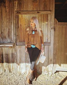 Jennifer wearing fringe boots, brown - black, and turquoise jewelry
