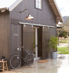 End of house. Put sliding barn doors over french doors to help keep house cool and block light when needed. Modern Barn, Modern Farmhouse, Contemporary Barn, Farmhouse Trim, Kitchen Modern, Barn Garage, Garage Doors, Barn Living, Future House
