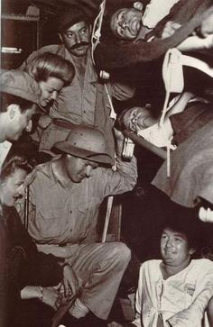 Bob Hope, Frances Langford & Jerry Colonna visiting men in sick bay during WWII