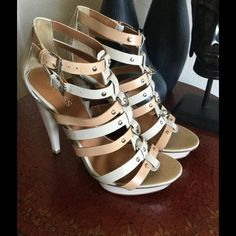 """Guess Nude Strapy Heels Very cool heels to go with any outfit.. The straps across the top are sexy. These are gently used like new.. Say 7 1/2.. But ware like a 8. Very cool looking heels and comfy to walk in4 1/2"""" heel Guess Shoes Heels"""