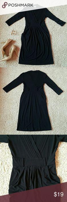 Worthington black v-neck stretchy formal dress Black stretchy dress by Worthington in good pre-owned condition. Deep v-neck, 2 pockets on the front  93% polyester  7% spandex Worthington Dresses Midi