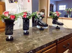Hockey flower decorations, could change the ice skate to a jazz shoe for DANCE! Hockey Birthday Parties, Hockey Party, Skate Party, Sports Party, Hockey Crafts, Hockey Decor, Hockey Room, Hockey Tournaments, Hockey Teams