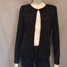 "Onyx Nite Black Glittery Bolero Jacket. Onyx Nite Black Glittery Bolero Jacket. Round Neck, Open Front, Long Sleeves 24"", Armpit to armpit 19"", Length of jacket 24"". 90% Acetato, 10% Espandex, 100% Ploiester. Made in U.S.A. Onyx Nite Jackets & Coats Blazers"