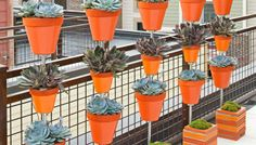 Build a space-saving tower of flowers by suspending terra-cotta pots over a concrete-block base. Make one, or create a row of them to serve as a privacy screen.