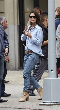 Au naturel! Katie Holmes looked effortlessly chic, wearing double denim during a stroll in New York City on May 4, 2014. With her hair down and her shades on, it didn't take much for the starlet to look like one hot mama!