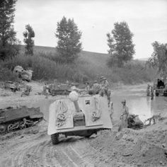 BRITISH ARMY ITALY 1944 (NA 1818) A 17-pdr anti-tank gun of 269 Battery, 87th Anti-Tank Regiment is towed across the River Foglia during the assault on the Gothic Line, 1 September 1944.