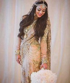#Love this #gold #bridal #saree from @sabyasachiofficial. Pretty #wedding #jewelry, too, including the waist #bling. #hautecouture #Repost @bridesofsabyasachi