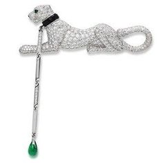 A diamond, onyx and emerald 'panther' brooch, by Cartier