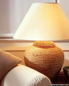 If you have a lamp that looks oddly simple maybe it's time to give it a makeover. You can do that with nothing but rope. First purchase a 100-foot length of 3-ply rope made of manila, jute or sisal. Start at the bottom of the lamp base and apply glue in 6-inch sections using a brush. Next press the rope to the glue and wrap it around the base. Press each layer against the one below it and trim the end on an angle and tuck it beneath the previous coil.
