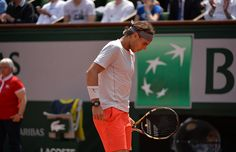 Rafael Nadal takes a moment to regroup during his match against German Daniel Brands.
