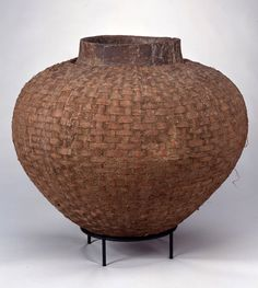 Africa | Vessel from the Tonga or Shona people of Zimbabwe | Earthenware Ceramic, Woven Cane, Fiber, Bark | Early 20th century