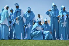 Women adorned in Somali flags celebrate Somalia's Independence Day at Konis stadium in Mogadishu on July 1. Today's celebrations mark 53 years since the Southern regions of Somalia gained independence from Italy and joined with the Northern region of Somaliland to create Somalia. AU UN IST PHOTO / TOBIN JONES.