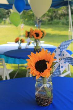 Great centerpiece for any occasion! Mason jars + sunflowers + pinwheels + balloons.