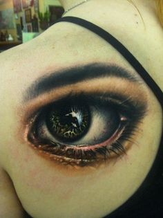 Realistic eye on shoulder blade by Johnny Smith at Off the Map Tattoo Easthampton, MA