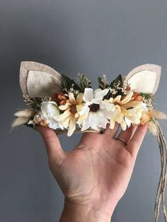 Tieback Woodland Fawn Flower Crown in all neutrals. Flowers are mounted on Natural Jute rope. Ears are made from Felt. Headband is adjustable and will fit any size baby, toddler or Mamas head. Just slip ends through loop and pull to fit head. Back of flowers are covered with felt for