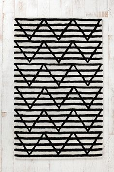 tufted black and white rug #urbanoutfitters