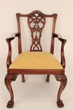 Wayne Chippendale Arm Chair.Hand carved Mahogany Chippendale style arm chair with a ribbon back and tassel design. Ball and claw foot design. Available in many finishes as well as any painted finish. COM 3/4 yard per chair.