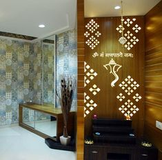 Entrance Foyer with Pooja Area – GharPedia – Decorating Foyer Glass Partition Designs, Living Room Partition Design, Pooja Room Door Design, Door Design Interior, Home Room Design, Jalli Design, Foyer Design, Ceiling Design, Temple Design For Home