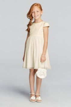 You will have your flower girl looking cute as a button in this all over lace dress.  Beautifully detailed all over lace bodice with cap sleeves.  A-line above the knee chiffon skirt.  Fully lined. Back zipper. Imported. Dry clean only.