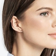 A pair of rose gold constellation ear crawlers and mini star studs that will always dazzle. | 25 Space-Themed Products That'll Add Light Years To Your Life