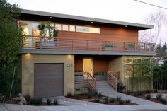 Modern railing design for balcony exterior contemporary with flat roof wood siding mid-century modern