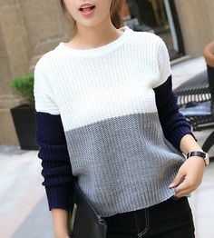 Crew neck color block knitted sweater.