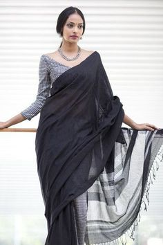A black white silver combination in cotton and rayon blends. Contemporary look most suitable for cocktail and evening occasions. These sarees are part of a spe Indian Attire, Indian Ethnic Wear, Saris, Indian Dresses, Indian Outfits, Lehenga, Saree Jackets, Modern Saree, Simple Sarees