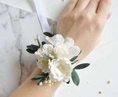 White flower wrist corsage Bridesmaids corsage Wrist Etsy is part of Bridesmaid corsage - Wrist Corsage Wedding, Prom Corsage And Boutonniere, Bridesmaid Corsage, Bridesmaid Flowers, Wedding Bridesmaids, White Corsage, Flower Corsage, Wrist Flowers, Prom Flowers
