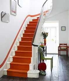 Painted Stair runner.  Love the creative pop of color in this otherwise calm room.  Entryway.  Home decor and interior decorating.