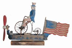 Uncle Sam Riding a Bicycle Whirligig Artist unidentified Probably New York State Pain on wood with metal 37 x 55 x Collection American Folk Art Museum, New York Gift of Dorothea and Leo Rabkin, Photo by John Parnell Patriotic Decorations, Patriotic Crafts, Primitive Antiques, Old Glory, Outsider Art, Antique Toys, First Nations, Wood Carving, Painting On Wood