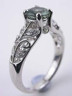 Antique Style Green Sapphire Engagement Ring, RG-3169d, An engagement ring with a floral and leaf pattern in 18k white gold romantically wraps the finger. The leaves and  bezel are set with eighteen round brilliant cut diamonds, totaling 0.18 carats. This is a new green sapphire engagement ring in the antique style. Ring size 6.0