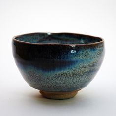 Japanese earthware tea cup reminds me of a midnight swim in a pristine, calm ocean