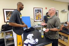 APRIL 22: Kobe Bryant  and head athletic trainer Gary Vitti of the  speaking in the training room before a game against the Oklahoma City Thunder