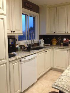 white cabinets and granite