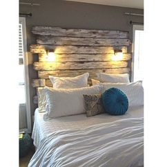 This+beautiful+rustic+headboard+also+serves+as+a+great+lighting+source